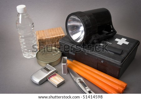 Items for emergency over gray - stock photo