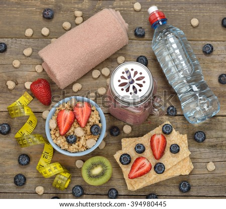 Items for sports on a wooden background, fitness and diet concept - stock photo