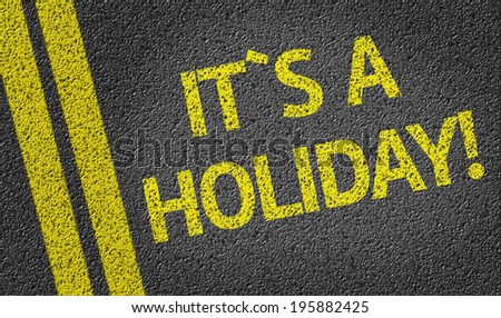 Its a holiday! written on the road - stock photo