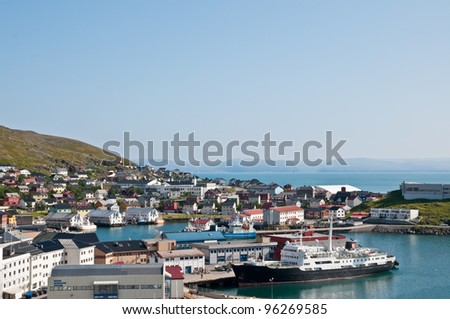 Its a port and cityscape of Honningsvag, one of the northernmost city in Norway and in the world, fishers and indusctrial vessels are at biggest port of Mageroya Island. - stock photo