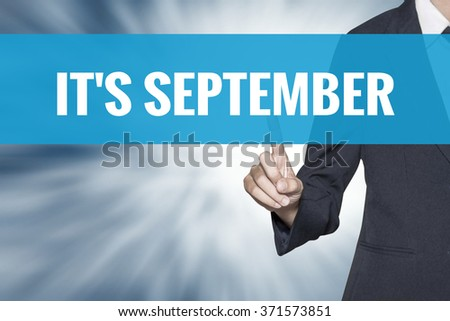 Its September word on virtual screen touch by business woman cyan sky tab - stock photo