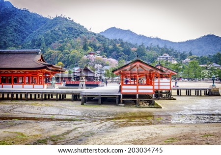 """Itsukushima Shrine is listed as a UNESCO World Heritage Site , best known for its """"floating"""" torii gate - Hiroshima , Japan - stock photo"""