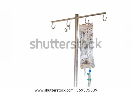 IV bag in a hospital filled with liquid attached to an infusion stand. - stock photo