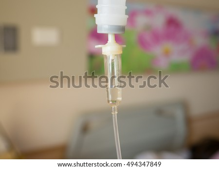 Iv-drop,Drip intravenous system on the background of work in hospital. Medical background.