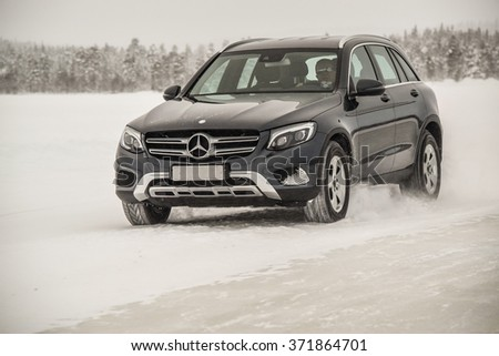 IVALO, FINLAND - January 28, 2016: Winter tire test is held at the proving ground. Test-driver performs a handling test on Mercedes-Benz GLC to determine the tire which provides the best grip on ice.