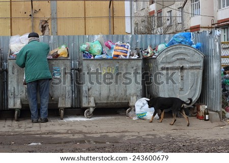 Ivano-Frankivsk, Ukraine - December 13, 2014:The person searches for something in garbage.