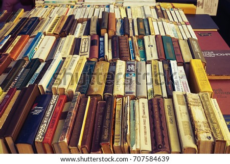 Ivano-Frankivsk, Ukraine - 24 March, 2015: a row of old books in Russian and Ukrainian on stalls on sale for petty sum of money