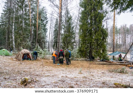 Ivanovo, Ivanovo region, Russia - April 19, 2015: the Cyclists in camp in the woods in snowy weather, April 19, 2015, Ivanovo, Ivanovo region, Russia.