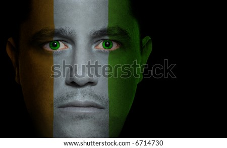 Ivorian flag painted/projected onto a man's face