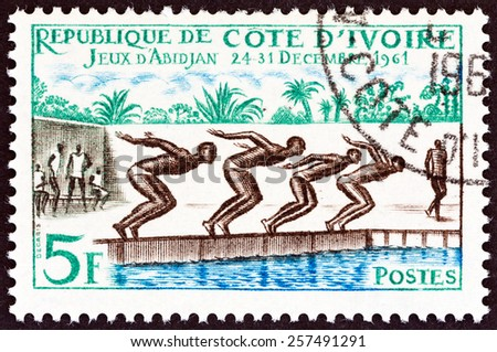 """IVORY COAST - CIRCA 1961: A stamp printed in Ivory Coast from the """"Abidjan Games """" issue shows swimming, circa 1961.  - stock photo"""