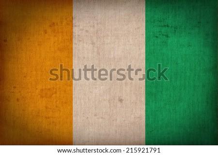 Ivory Coast flag pattern on the fabric  texture ,retro vintage style - stock photo