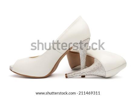 Ivory female wedding footwear isolated over white background - stock photo