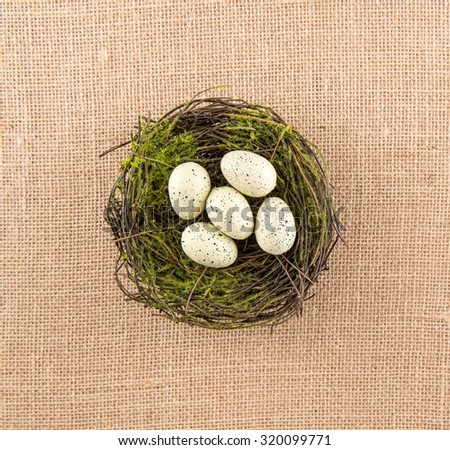 Ivory Speckled Eggs In Nest - stock photo