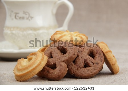 Ivory tea cup with yummy biscuits on Food and Drink theme