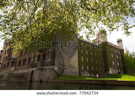 Ivy wall of St John college. View from Cam river. Cambridge. UK. - stock photo
