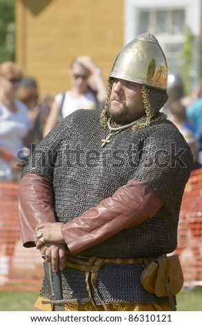 "IZBORSK, RUSSIA - AUGUST 6: Unidentified man in a knightly armor take part in festival ""Iron hailstones"" on August, 6 2011 in Izborsk, the Pskov area, Russia."