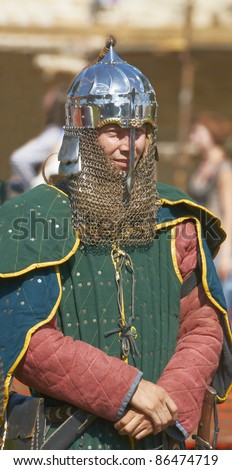 "IZBORSK, RUSSIA - AUGUST 6: Unidentified man in a knightly armor take part in festival ""Iron hailstones"" on August, 6 2011 in Izborsk, the Pskov area, Russia. - stock photo"
