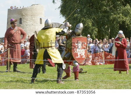 "IZBORSK, RUSSIA - AUGUST 6: Unidentified men in a knightly armor take part in festival ""Iron hailstones"" on August, 6 2011 in Izborsk, the Pskov area, Russia. - stock photo"