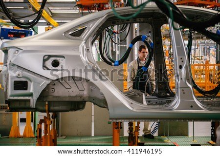 Izhevsk, Russia - SEPTEMBER 25: Car Assembly Line. Start Of Product of LADA Vesta at the Automobile Factory IZHAVTO - AVTOVAZ, on September 26, 2015 in Izhevsk - stock photo