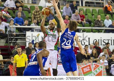 IZMIR - FEBRUARY 13: Pinar Karsiyaka's BRACEY WRIGHT shoots to the basket in Turkish Basketball League game between Pinar Karsiyaka 90-81 Istanbul BBSK on February 13, 2016 in Izmir - stock photo