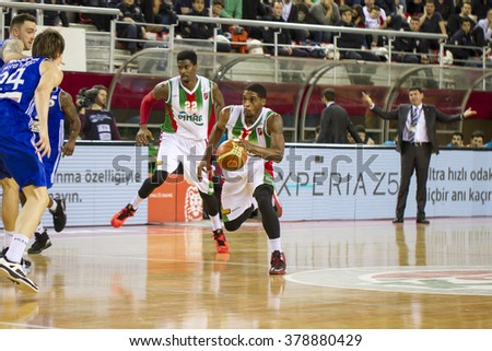 IZMIR - FEBRUARY 13: Pinar Karsiyaka's LAZERIC JONES drives to the basket in Turkish Basketball League game between Pinar Karsiyaka 90-81 Istanbul BBSK on February 13, 2016 in Izmir - stock photo