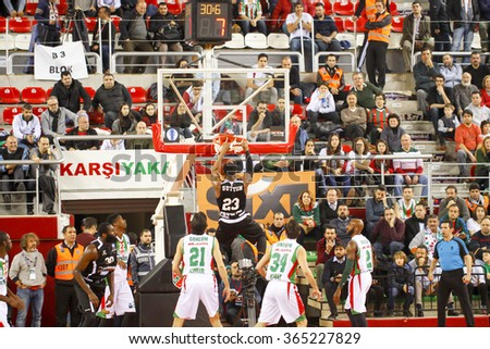 IZMIR JANUARY 20: Dolomiti Energia Trento's DOMINIQUE SUTTON shoots to the basket in Eurocup game between Pinar Karsiyaka 79-85 Dolomiti Energia Trento on January 20, 2016 in Izmir - stock photo
