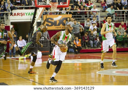 IZMIR - JANUARY 10: Pinar Karsiyaka's BRACEY WRIGHT drives to the basket in Turkish Basketball League game between Pinar Karsiyaka 87-83 Akin Corap Yesilgiresun on January 10, 2016 in Izmir - stock photo