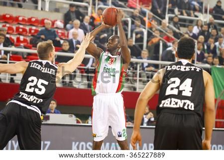IZMIR JANUARY 20: Pinar Karsiyaka's JOSHUA CARTER shoots to the basket in Eurocup game between Pinar Karsiyaka 79-85 Dolomiti Energia Trento on January 20, 2016 in Izmir - stock photo