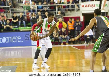 IZMIR - JANUARY 10: Pinar Karsiyaka's KENNY KENNETH GABRIEL drives to the basket in Turkish Basketball League game between Pinar Karsiyaka 87-83 Akin Corap Yesilgiresun on January 10, 2016 in Izmir - stock photo