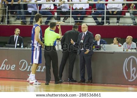 IZMIR  JUNE 16:Coach UFUK SARICA and Coach DUSAN IVKOVIC standing near the bench in Turkish Basketball League game between Pinar Karsiyaka 91-88 Anadolu Efes on June 16, 2015 in Izmir - stock photo