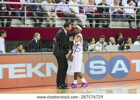IZMIR - JUNE 06: Pinar Karsiyaka's Coach UFUK SARICA gives tactics to BOBBY ROBERT LEE DIXON in Turkish Basketball League game between Pinar Karsiyaka 82-64 Fenerbahce Ulker on June 06, 2015 in Izmir - stock photo