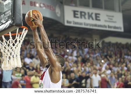IZMIR - JUNE 06: Pinar Karsiyaka's DJ DARRYL EUGENE STRAWBERRY JR. slam dunks to the basket in Turkish Basketball League game between Pinar Karsiyaka 82-64 Fenerbahce Ulker on June 06, 2015 in Izmir - stock photo