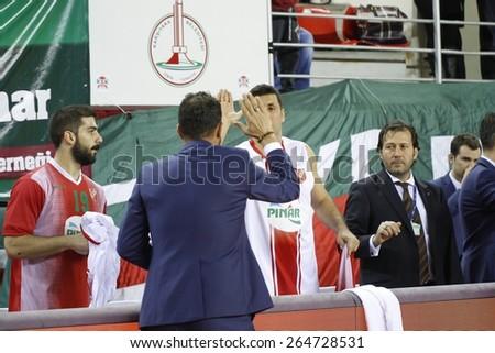 IZMIR   MARCH 21: Pinar Karsiyaka's Coach UFUK SARICA  thanks his player INANC KOC in Turkish Basketball League game between Pinar Karsiyaka 66-71 Royal Hali Gaziantep on March 21, 2015 in Izmir - stock photo