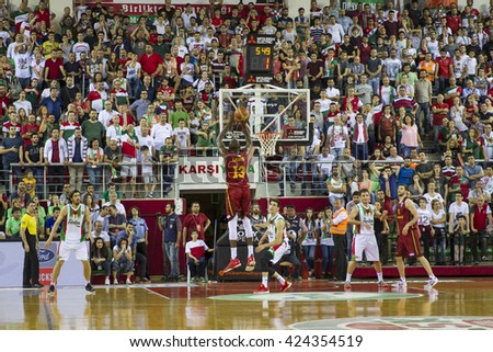 IZMIR - MAY 20: Galatasaray Odeabank's Stephane Lasme shooting to the basket in Turkish Basketball League game between Pinar Karsiyaka 62-65 Galatasaray Odeabank on May 20, 2016 in Izmir11 - stock photo
