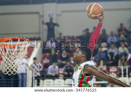 IZMIR NOVEMBER 29: Pinar Karsiyaka's KENNY KENNETH BENARD GABRIEL slam dunks in Turkish Basketball League game between Pinar Karsiyaka 81-80 Muratbey Usak Sportif on November 29, 2015 in Izmir - stock photo