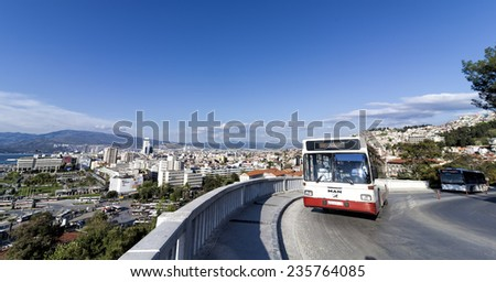IZMIR, TURKEY - APRIL 11, 2014: The aerial view of Konak Square along with an urban bus which is one of the means of transport in Izmir, Turkey. - stock photo