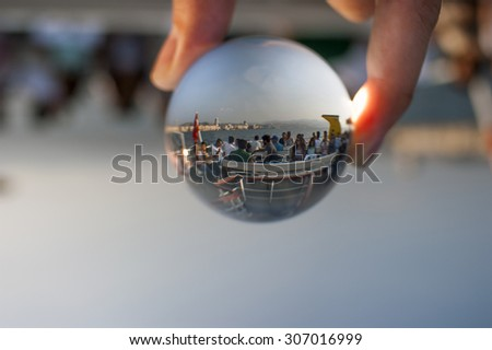 Izmir, Turkey - August 16, 2015: Glass ball and people on a passenger ship. - stock photo