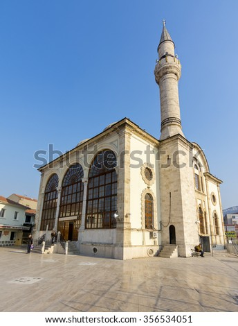 Izmir, Turkey - December 29, 2015 : Historical Kestane Pazari Mosque view in Kemeralti. Kemeralti is famous old shopping district of the Izmir city.