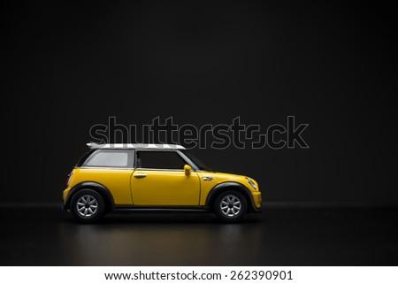 Izmir, Turkey - February 28, 2015.  Mini Cooper S Toy car on black background. - stock photo