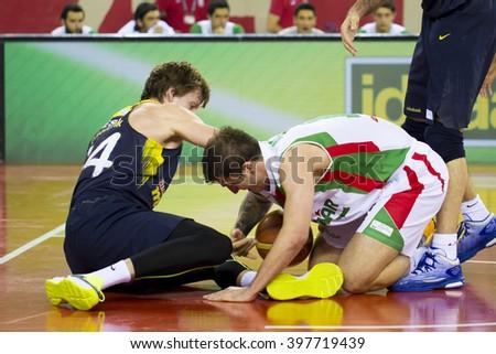 IZMIR, TURKEY - MARCH 20: Pinar Karsiyaka's CAN ALTINTIG  steals the ball in Turkish Basketball League game between Pinar Karsiyaka 86-81 Fenerbahce Ulker on March 20, 2016 in Izmir - stock photo