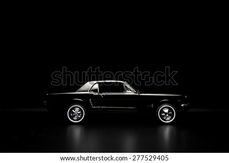 Izmir, Turkey - May 13, 2015.  Ford mustang 260 toy car product shot. Side view on a black background.  - stock photo