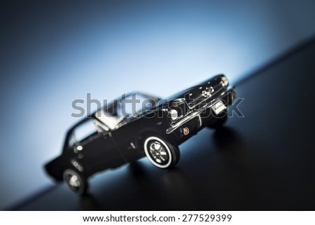 Izmir, Turkey - May 13, 2015.  Ford mustang 260 toy car product shot. Side view on a blue background.  - stock photo