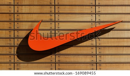 IZMIR,TURKEY - NOVEMBER 27: Exterior of a sporting goods store displaying  Nike  on November 27, 2013 in Izmir, Turkey. Name from Nike, the goddess of victory in Greek mythology gets. - stock photo