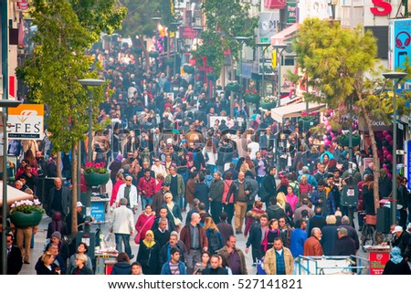 IZMIR, TURKEY - NOVEMBER 25, 2016: People crossing a busy(carsi) street in izmir.  Carsi street  is a major commercial intersection and neighborhood in downtown