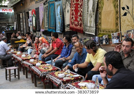 IZMIR, TURKEY - OCTOBER 3, 2009: Guests in the tea house in the center of the city drink tea and coffee - stock photo