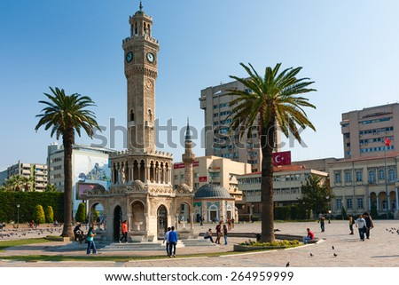 IZMIR, TURKEY - OCTOBER 04, 2014: Konak Square, Clock Tower, symbol of Izmir, built in 1901 and Yali Mosque in the background