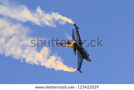 IZMIR, TURKEY - SEPTEMBER 09: Turkish Air Force Solo Aerobatics Display Team Solo Turk performs during Izmir Independence Day on September 09, 2012 in Izmir, Turkey - stock photo