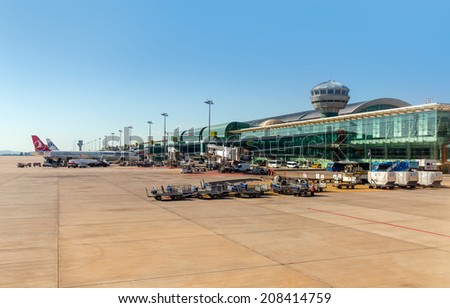 IZMIR - TURKEY , SEPTEMBER 18: Turkish Airlines aircraft parked in the Adnan Menderes Airport, on September 18 2013 in izmir  Turkey. 4th busiest airport in Turkey.  - stock photo