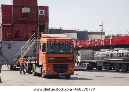 IZMIT, TURKEY - MAY 29, 2009: 1998 Dutch Iveco Eurotech, 4500cc, 426 HP Semi-trailer truck and other trucks at port in Izmit, Turkey