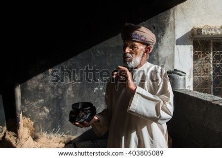 JABAL AL AKHDAR, OMAN - CIRCA APRIL 2016: and old Omani man is explaining how rose water gets made